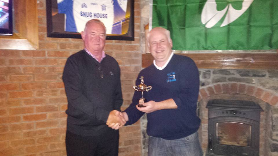 Kildalkey Captain Tom Carroll (right) receives the Ryder Cup from Marcies in 2015